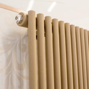 Detail vzorkové koupelny v koupelnovém studiu Gremis - koupelnový radiátor